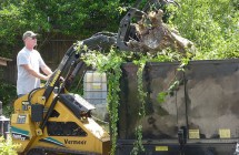 Tom uses the Vermeer mini loader to lift tree debris